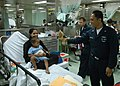 US Navy 060701-N-3532C-032 Navy Hospital Corpsman 3rd Class Ronald Bayaca of San Diego, Calif., entertains a young patient aboard the U.S. Military Sealift Command hospital ship USNS Mercy (T-AH 19).jpg