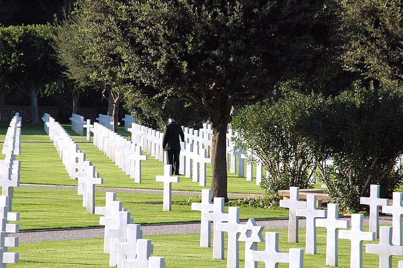 File:US Navy 061117-N-6544L-004 A Soldier assigned to the American Embassy in Tunis touches a headstone at the North African American Cemetery during a wreath-laying ceremony honoring American veterans.jpg