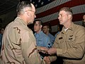 US Navy 061221-N-3080T-007 Chief of Naval Operations (CNO) Adm. Mike Mullen personally congratulates each of 34 Sailors, after administering the oath of reenlistment.jpg