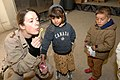 US Navy 070116-N-8218W-030 U.S. Air Force 1st Lt. Lea Ann Fracasso blows bubbles for some Iraqi children at the Civilian Military Operations Center (CMOC) near Baghdad, Iraq.jpg