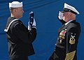 US Navy 070323-N-8102J-196 USS John F. Kennedy (CV 67) Senior Sailor of the Year, Electronics Technician 1st Class Craig T. Johnson, delivers the ensign to Command Master Chief Charles L. Dassance during the ship's decommission.jpg