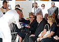 US Navy 070828-N-8655E-002 Retired Vice Adm. Albert Konetzni, presents the American flag to Mrs. Margaret Fluckey.jpg