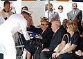 US Navy 070828-N-8655E-002 Retired Vice Adm. Albert Konetzni, presents the American flag to Mrs. Margaret Fluckey.jpg