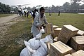 US Navy 071204-M-1226J-024 Citizens of Bawfal offload food rations from a Marine CH-46E, assigned to the 11th Marine Expeditionary Unit.jpg