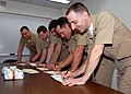 US Navy 071206-N-7656R-001 The chiefs aboard USS Ohio (SSGN 726) sign Christmas cards to be sent to other chiefs serving in the Middle East on Individual Augmentee assignments.jpg