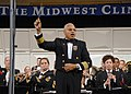 US Navy 071219-N-0773H-036 Capt. George N. Thompson conducts the Navy Band in the playing of the National Anthem at the 61st annual Midwest Clinic.jpg