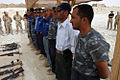US Navy 080715-M-1615T-001 Iraqi policemen stand in line waiting to receive their certificates of completion for a basic water patrol course they graduated from at the Haditha Dam, which is near Haditha.jpg