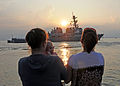 US Navy 080829-N-1713L-032 Family members watch their loved ones man the rails aboard the guided-missile destroyer USS Ramage (DDG 61) as the ship deploys from Naval Station Norfolk.jpg