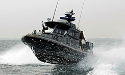US Navy 090210-N-9671T-144 A port security boat patrols the waters near Kuwait Naval Base.jpg