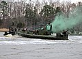 US Navy 090319-N-4267W-272 Sailors assigned to Riverine Squadron (RIVRON) 3 simulate towing a damaged riverine patrol boat while under attack during a patrol exercise.jpg