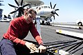 US Navy 090319-N-6604E-067 Aviation Ordnanceman 3rd Class Carolina Franco removes corrosion from the barrel of an M61-A1 20mm machine gun aboard the aircraft carrier USS Dwight D. Eisenhower (CVN 69).jpg