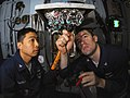 US Navy 090422-N-6597H-021 lectronics Technician 3rd Class Alvin Carrillo, left, from San Diego, Calif., and Electronics Technician 2nd Class Christopher White, from Framer City, Ill., troubleshoot faulty buttons on the AN-SPN.jpg