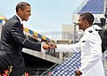 US Navy 090522-N-1026O-003 U.S. President Barack Obama congratulates a newly commissioned Navy ensign during the U.S. Naval Academy Class of 2009 graduation and commissioning ceremony.jpg