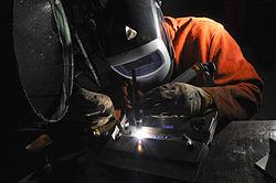 US Navy 090715-N-5821P-002 Aviation Support Equipment Technician Airman Anthony Hammond performs tungsten inert gas welding during a training evolution.jpg