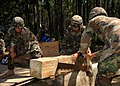 US Navy 090824-N-8816D-118 Seabees assigned to Naval Mobile Construction Battalion (NMCB) 133 saw timber for a tower during a field training exercise at Camp Shelby, Miss.jpg