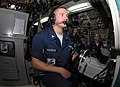 US Navy 091125-N-7705S-035 Torpedoman's Mate 3rd class Christopher Machreiner, from Pittsburgh, Pa., mans the helm of the Los Angeles-class attack submarine USS Montpelier (SSN 765).jpg