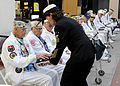 US Navy 091204-N-7032B-152 Command Master Chief Kathleen A. Hansen, assigned to Naval Medical Center San Diego, presents an American flag to retired Chief Electrician's Mate Stuart Hedley, a Pearl Harbor survivor.jpg