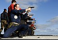 US Navy 100130-N-3707A-091 Lt. j.g. Anthony Cole, from Roundup, Mont., takes part in 9mm pistol qualifications on the fantail of the Nimitz-class aircraft carrier USS John C. Stennis (CVN 74).jpg