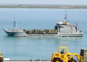 US Navy 100301-N-2000D-010 Army Landing Craft Unit (LCU) 2031 transports vehicles from USS Carter Hall (LSD 50).jpg