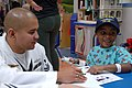 US Navy 100414-N-4716P-025 ) Gas Turbine System Technician (Electronic) Francisco Zapata, colors with a patient at the Joe DiMaggio Children's Hospital hematology and oncology ward.jpg