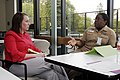 US Navy 100511-N-2304O-064 Lt. Cmdr. Thecly Scott advises Lt. j.g. Michele Guagliardo during a speed mentoring event in the Terrace Dining Room of Naval Hospital Bremerton.jpg