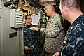 US Navy 110210-N-FG395-017 Army Gen. Raymond T. Odierno sks Missile Technician 1st Class Brandon Bates how he maintains the missiles aboard USS Rho.jpg