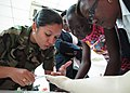 US Navy 110418-N-QD416-115 Nicaraguan army Lt. Lilian Ponce demonstrates how to properly suture a patient for members of the Jamaican Ministry of H.jpg