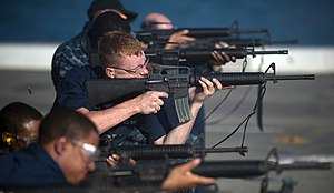 US Navy 111210-N-PB383-726 Sailors fire at their targets with M-16 service rifles during small arms qualifications aboard the amphibious transport.jpg