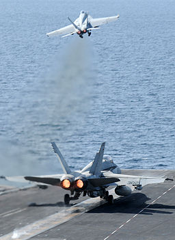 US Navy 120216-N-XC743-112 An F-A-18C Hornet assigned to the Vigilantes of Strike Fighter Squadron (VFA) 151 and an F-A-18E Super Hornet assigned t