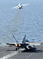 US Navy 120216-N-XC743-112 An F-A-18C Hornet assigned to the Vigilantes of Strike Fighter Squadron (VFA) 151 and an F-A-18E Super Hornet assigned t.jpg