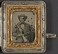 Unidentified soldier in Confederate cavalry uniform with Sharps carbine, pistol, and knife LCCN2012650038.jpg