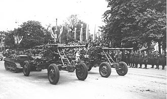 C2P - C2P tractors towing the 40 mm Bofors guns during the May 3rd Constitution Day parade of 1939