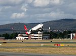 VH-VXM taking off from Canberra Airport December 2012.jpg
