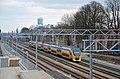 VIRM 8638 richting Nijmegen rijdt rangeerterrein voorbij (8628141188).jpg