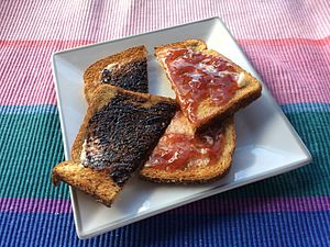 Toast - Left: Toast with butter and vegemite. Right: With butter and strawberry jelly.