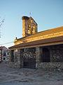 Vista lateral de iglesia en La Serna del Monte.jpg