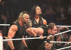 The Shield (professional wrestling) - The Shield in April 2014; from left to right: Seth Rollins, Dean Ambrose, and Roman Reigns (back)