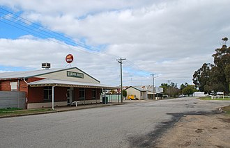 Wakool - The main street of Wakool, looking south towards the general store.  The Wakool Hotel is in the foreground.