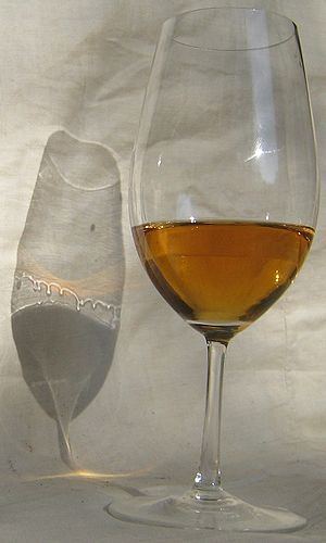 Marangoni effect - Tears of wine show clearly in the shadow of this glass of wine with a 13.5% alcohol content