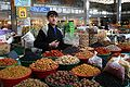 Young Tajikistani dry fruit seller.jpg