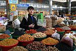 Young Tajikistani dry fruit seller.jpg