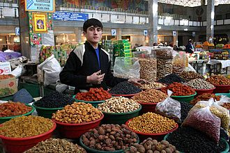 A Tajik dry fruit seller Young Tajikistani dry fruit seller.jpg