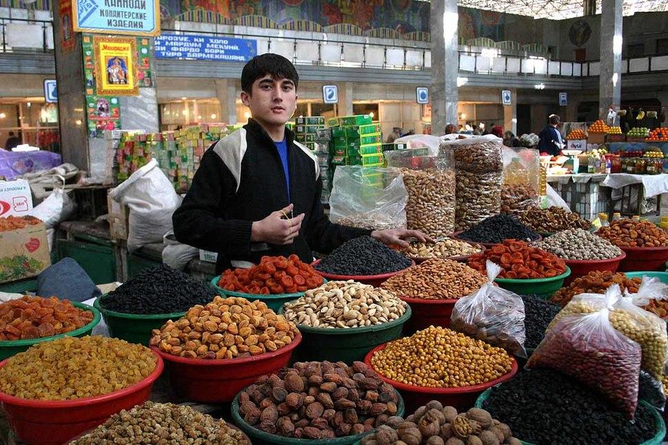 Young Tajikistani dry fruit seller