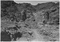 """Looking downstream into open cut and excavation for Arizona spillway. Shovel is near location of inclined spillway... - NARA - 293668.tif"