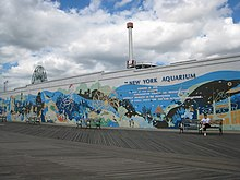 The boardwalk outside the New York Aquarium, with a mural on the aquarium wall