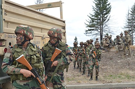 Indian Army soldiers during a military exercise, 2019 1-2 Stryker Brigade Combat Team and Indian Army Soldiers move as one fireteam storming Leschi Town, a training ground outside of Joint Base Lewis-McChord during Yudh Abhyas 2019.jpg