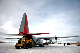 13th Air Expeditionary Group - An LC-130 Hercules is unloaded Nov. 27 on the ice runway near McMurdo Station, Antarctica, during Operation Deep Freeze.
