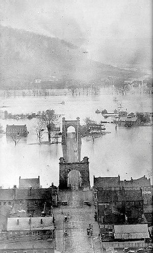 Wheeling Suspension Bridge - Flood of 1852 - Earliest known photograph of the Wheeling Suspension Bridge. http://wheeling.weirton.lib.wv.us/photos/brown/brown24.htm