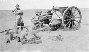 Nottinghamshire Royal Horse Artillery - An 18 pounder crew of another battery in action in the open desert of lower Mesopotamia, March 1917.