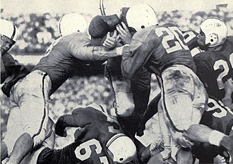 Quarterback sneak - Maryland quarterback Jack Scarbath tallies the first score in the 1952 Sugar Bowl on a successful quarterback sneak.